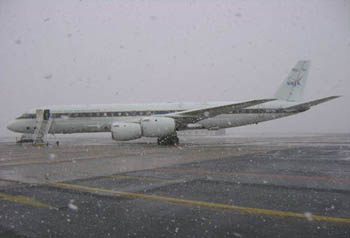 DC 8 on tarmac. Snow